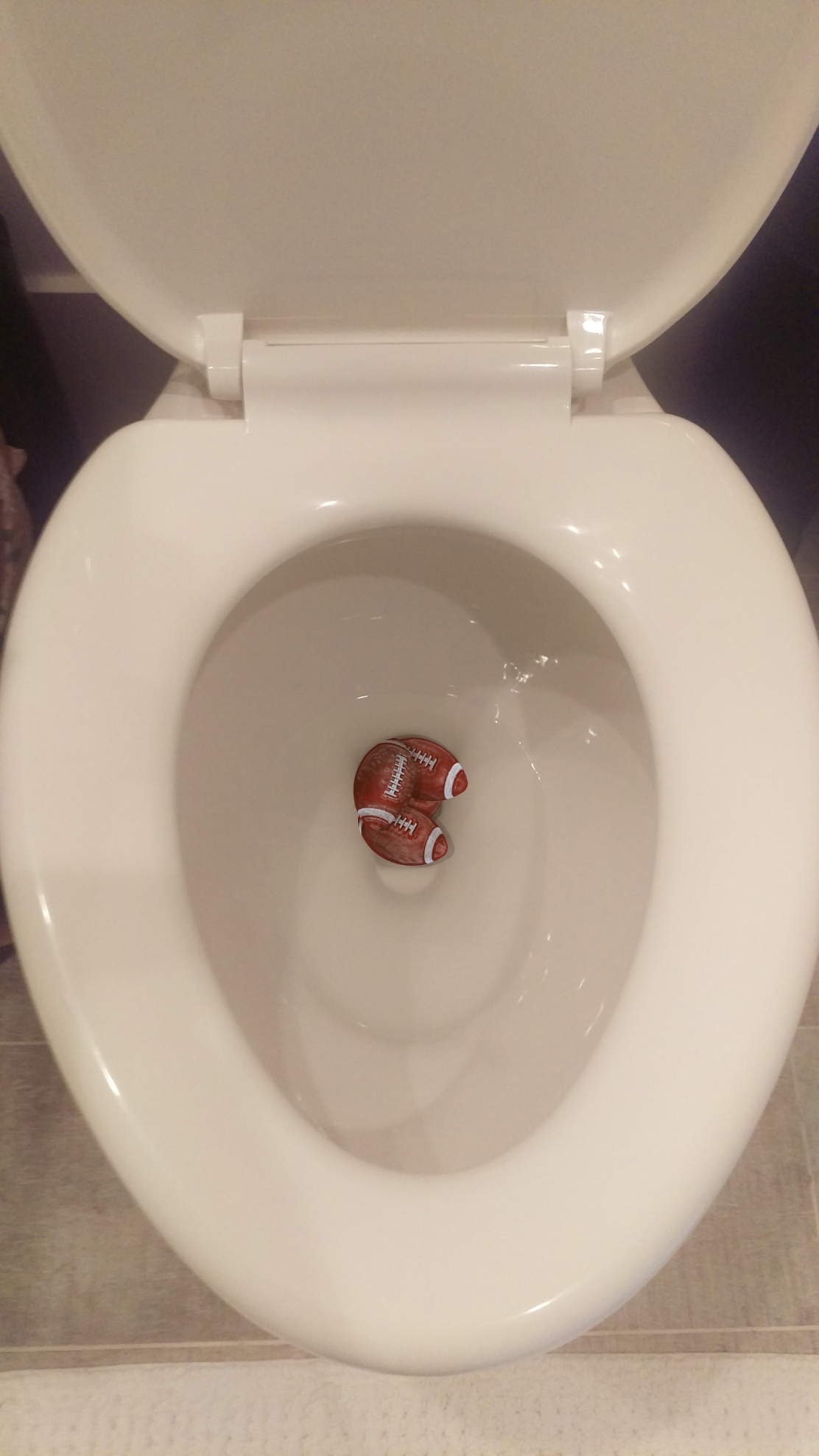 4. Clog his toilet with mini footballs